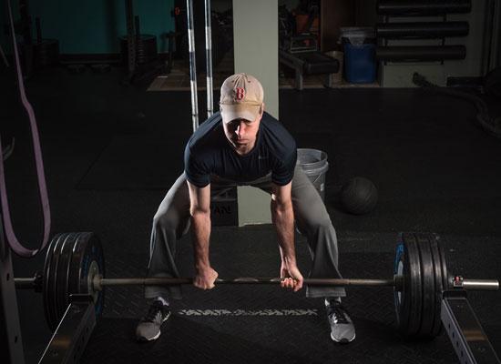 man exercising in fitness center