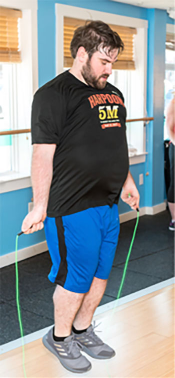 man exercising in fitness center
